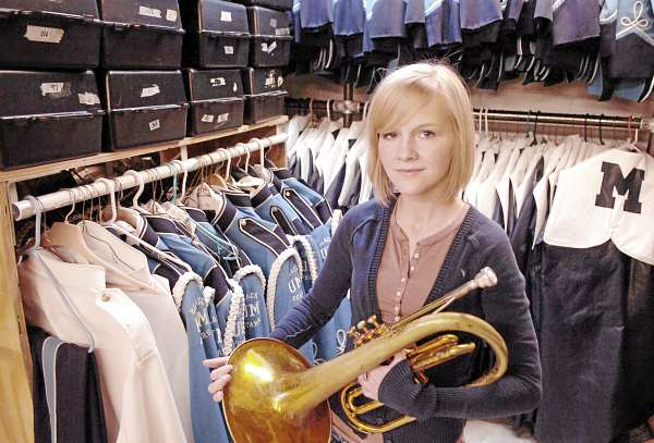 University of Maine graduate student Ashley Drew poses for a portrait with the horn she plays in the school's pep band Friday, March 19, 2010 on campus in Orono. The 23-year-old musician also plays piccolo in the symphonic band and tenor saxophone in the jazz band but has had to curb her participation in recent months due to a setback in December with cystic fibrosis, a genetic condition she has been battling her whole life.