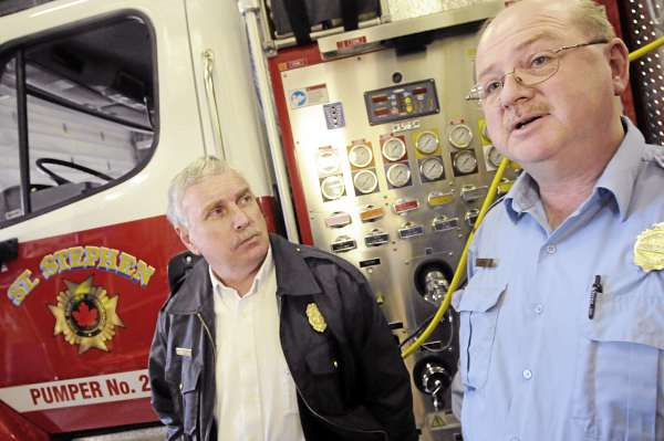 Calais Fire/E.M.S. Chief Dan Carlow, left, and St. Stephen, N.B. Fire Chief Jeff Richardson talk with the BDN at the St. Stephen F.D. headquarters, Tuesday, March 23, 2010. &quot We have confidence putting our lives in their hands and I think they feel the same way about us,&quot said Chief Carlow. Calais and St. Stephen fire departments have had a long-time mutual aid agreement.