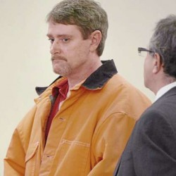 Perley G. Goodrich Jr. (left) of Newport, with the aid of his defense attorney Jeffrey Silverstein (right), entered pleas of not guilty and not criminally responsible by reason of insanity at his arraignment in February 2010 in Bangor in the shooting death of his father, Perley Goodrich Sr.