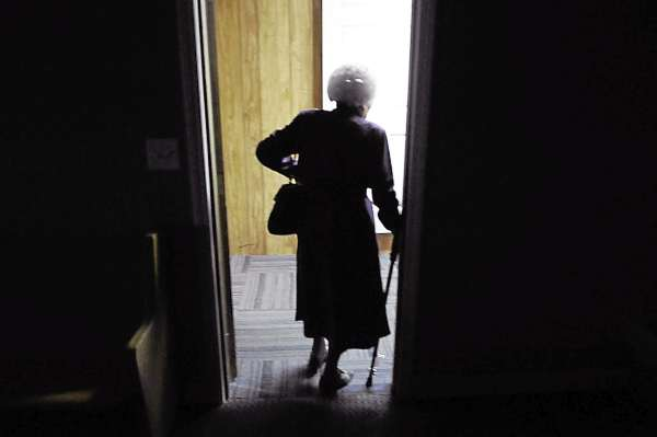 Louise Church of Corinth exits her Sunday school classroom following her morning lesson at at Charleston Pentecostal Church on March 27, 2011. &quotI felt the call of God on my life as a young person, &quot said Church who turned 90 in February.  &quotI love to teach and I love the word of God.&quot