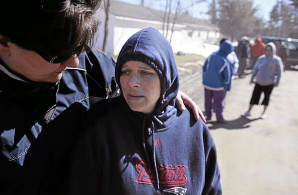 Samantha Rancourt, center, was comforted by neighbor Ruth Morrill, left, as firefghters doused a fire that broke out at the Rancourt family home on Pineview Drive in Winterport early Sunday afternoon, March 27, 2011. Rancourt said she was in Bangor running errands when the fire broke out and hurried back when she heard the news. Six of her children were at home with a babysitter and safely exited the home and went to Ruth Morill's home Sunday afternoon.