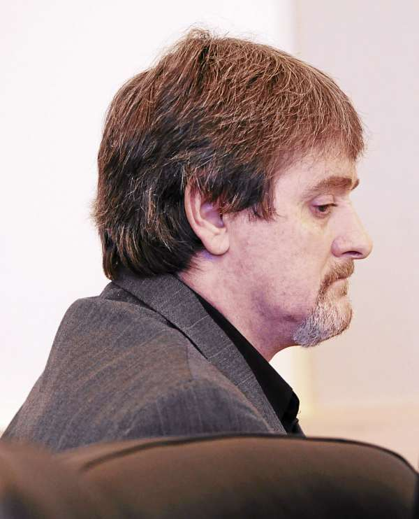 Perley Goodrich Jr. sits quietly as his attorneys have a sidebar with Superior Court Justice William Andrews during opening arguments for his trial in which Goodrich is accused of killing his father and pistol whipping his mother at his parents' home in Newport in October 2009.