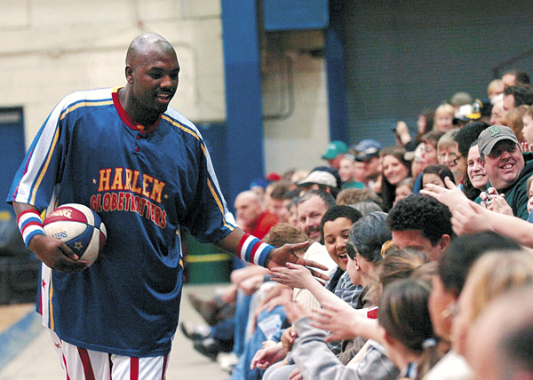 Big Easy Lofton of the Harlem Globetrotters meets fans before the Globetrotters game against the Washington Generals on Tuesday, March 30, 2011, at the Bangor Auditorium.
