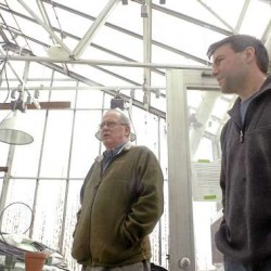 Admininstrative office Dave Lavway (left), and biological science technician Ben LeGasse, right, in a greenhouse at the New England Plant, Soil, and Water Research Laboratory in Orono on Wednesday. Due to a recent cut in federal funding, the USDA laboratory is slated for closure.