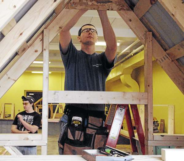Student Brian Shanahan, 17, of Springfield, works on a model roof in a carpentry class at Lincoln's Region III technical school on Wednesday. The $2.4 million addition to the school is just about finished.