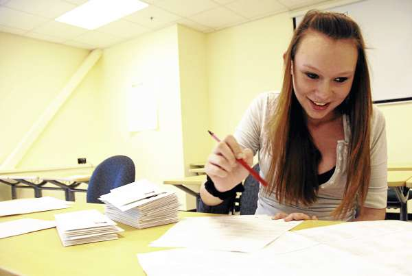 Student Lindsay Wright, 16, of Lincoln, compiles mail as part of her health sciences class at Lincoln's Region III technical school on Wednesday.
