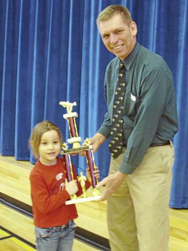 Brooklynne Blocker of Dover-Foxcroft, a SeDoMoCha Elementary School kindergarten pupil, received a trophy and a $1,000 check Wednesday for catching the largest pickerel in the Sebago Lake Rotary Club's fishing derby held March 5-6. Blocker caught a 4.29 pound pickerel from Sebasticook Lake in Newport while fishing with her grandparents, Kelley and Jerry Dority of Newport. Making the presentation Wednesday was Tom Noonan, derby director.