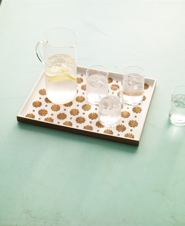 To entertain in style this spring, give a plain serving tray a creative boost with decorative cork cutouts.