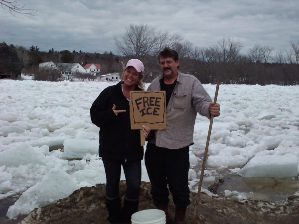 Philly and Carl Spencer try to make the most of a bad situation Sunday afternoon while monitoring a big ice jam on the Mattawamkeag River near their house.