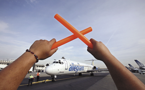 An Allegiant Air jet is shown in Los Angeles, Calif., in 2009.  The airline, which also flies from Bangor to Orlando, Fla., is considering a plan in which ticket prices could rise and fall with the price of jet fuel.