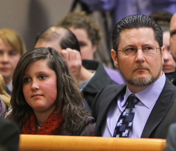 Jaimie Cates and her father, David Cates, sit in Hillsborough County Superior Court after the sentencing of Christopher Gribble on Friday, March 25, 2011, in Nashua, N.H. Gribble, who admitted he took part in a machete and knife attack on Jamie and her mother, was convicted of murder Friday, after jurors rejected his claim of insanity.