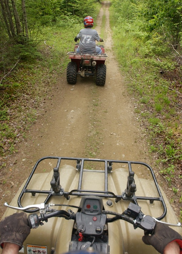 ATV riders travel on a private trail in Hermon in 2002. A new bill would require recreational users to gain the owner's written permission before using private land.