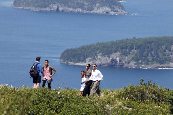 Acadia National Park Superintendent Sheridan Steele leads President Barack Obama, first lady Michelle Obama and their daughters Malia and Sasha during their visit to Cadillac Mountain in Acadia National Park in Bar Harbor in 2010.
