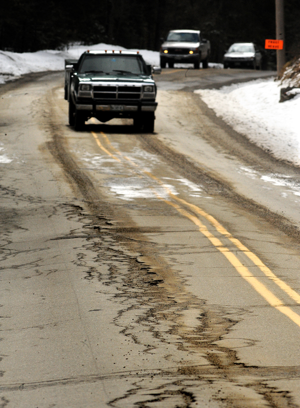 People drive on Rt-46 in Deadham.  Sections of this road are notorious during the spring, forcing drivers to slow to a crawl to negotiate frost heaves and pot holes.