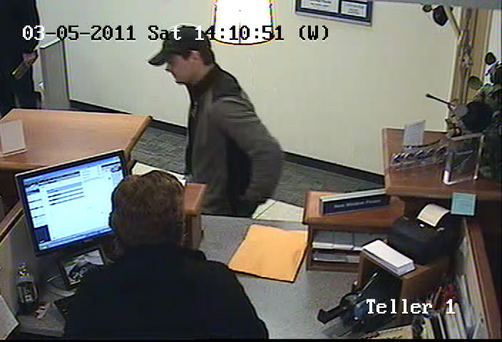 At approximately 2:18 p.m. Saturday, March 5, 2011, a man described as 25 to 35 years old, wearing a two-tone grey and black spring jacket and black ball cap, walked into the Bangor Savings Bank branch located at 652 Broadway in Bangor and reportedly robbed the bank.