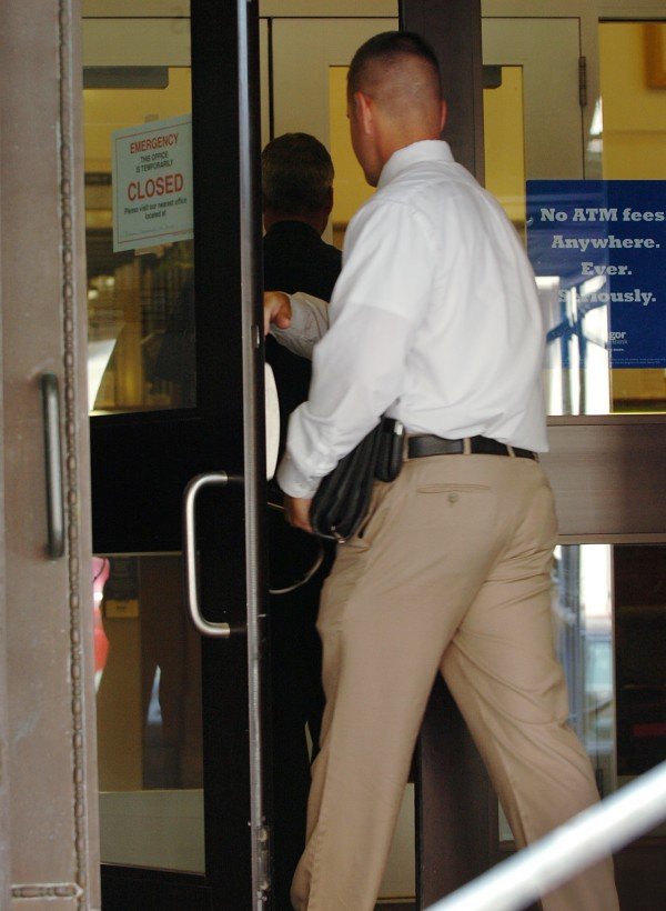 Bangor Police Department members enter Bangor Savings Bank at 3 State St. on Tuesday, July 6, 2010 where a robbery occured shortly after 9:30 a.m. Matisha Marie Pitts has been convicted of robbing the bank and sentenced to four years.