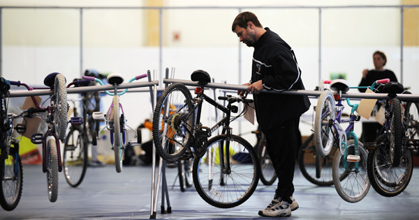 Eric Whitman of Old Town looks over bikes at the Great Maine Bike Swap at the University of Maine in Orono in 2009. Whitman was looking for a used bike for one of his two sons.
