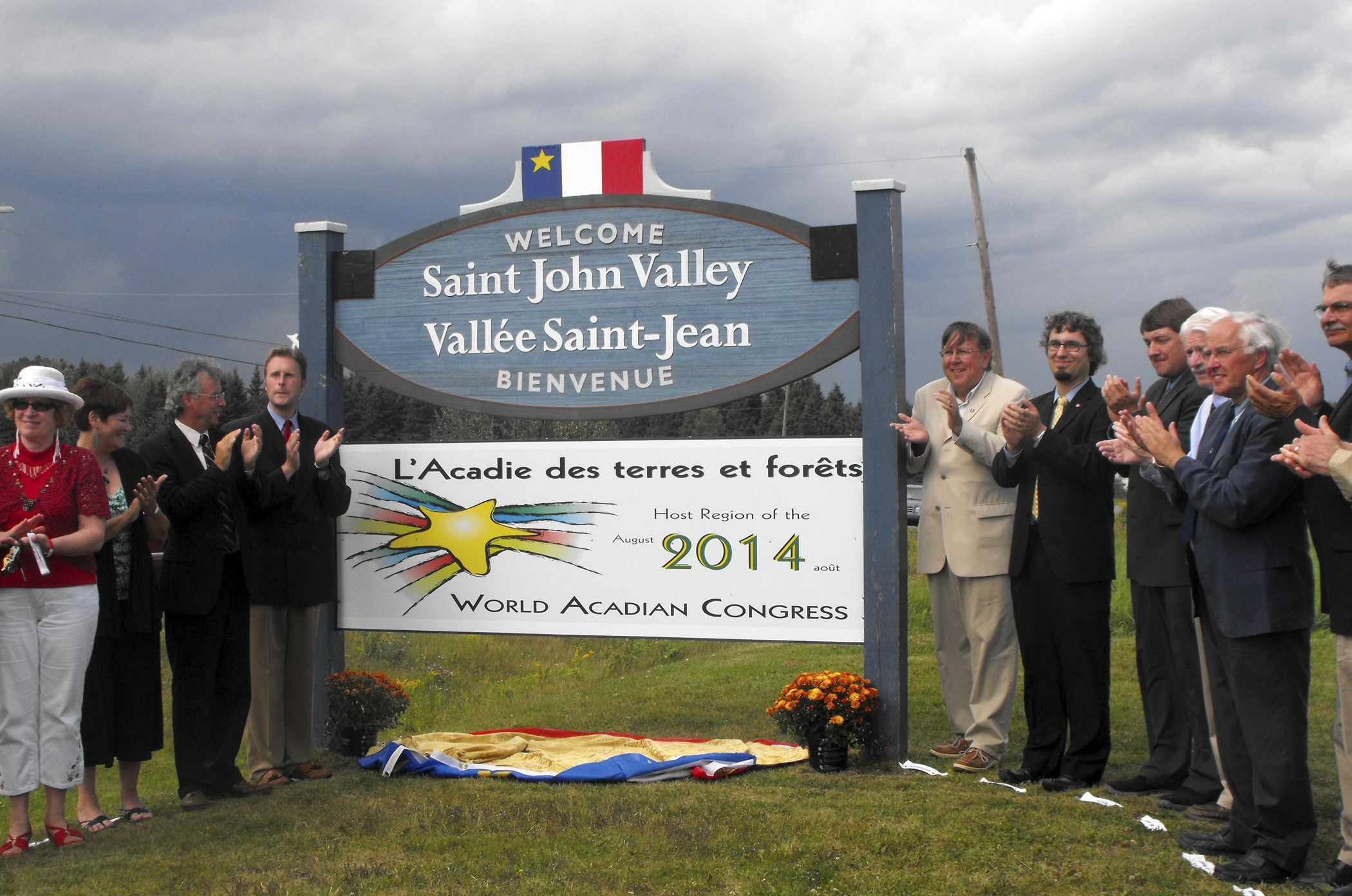 Organizers of the 2014 World Acadian Congress from both Maine and Canada gathered with Maine legislators and others in August in Cyr Plantation for the unveiling of one of four bilingual signs that will be erected in the St. John Valley to welcome people to the host region of the massive celebration.