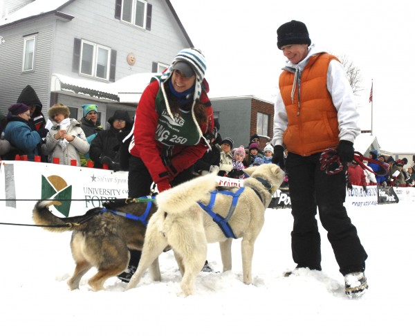Irving Woodlands Can Am Crown 250-Mile Sled Dog Race musher Jaye Foucher (left) checks her leaders with handler Jill Carter at the start of the race Saturday, March 5,