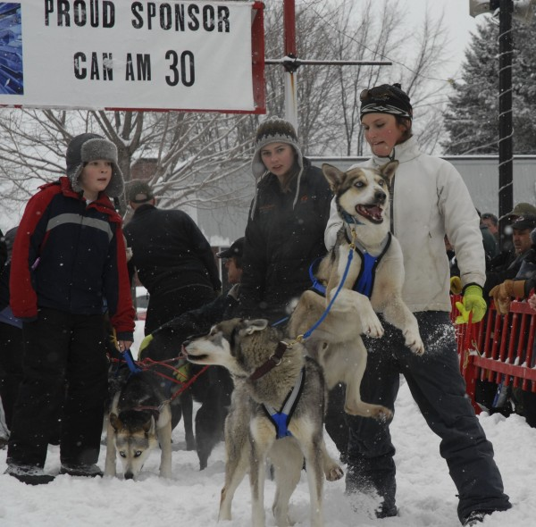 Amy Dionne (right) of St. David hangs on to the lead dog on her sister Holly Dionne's team at the start of the Pepsi Bottling Co. Can Am Crown 30-Mile Sled Dog Race Saturday, March 5, 2011.