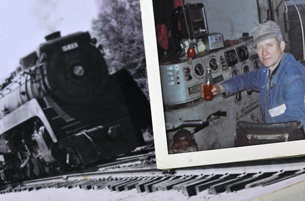 Cecil Miller, 95,  pulled out several photos from his career, including an old black and white photo of a 5400 HP  freight engine he operated and a photo of him at the controls of another engine. Retired for over 35 years, he said he spent much of his career as a train engineer.