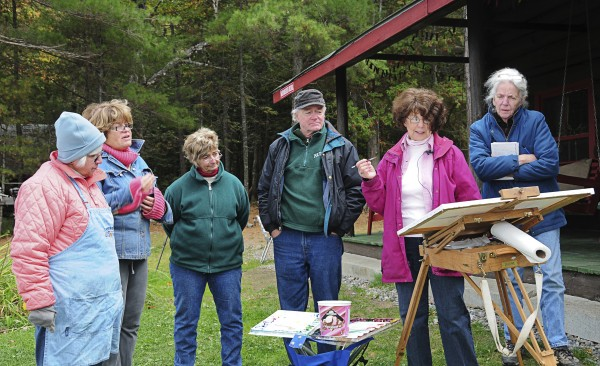Bath landscape and still life artist Evelyn Dunphy (second from right) teaches her students plein air watercolor techniques at her three-day fall workshop in 2009 at the former camp of the famous American landscape painter Frederic Church (1826-1900) on Millinocket Lake.