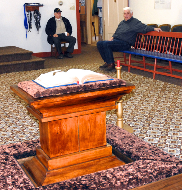 John Connors (right) has been a member of the Fort Kent order of Freemasons for most of his life and is sorry to see his lodge slated for destruction. On Saturday he welcomed members of the public like Eugene Michaud of St. Agatha to the order's first open house in its 107-year history. The building will be torn down this spring to make way for the new international bridge and the members relocated to a building across from the Fort Kent Town Office. &quotThere are a lot of memories in this building,&quot Connors said.