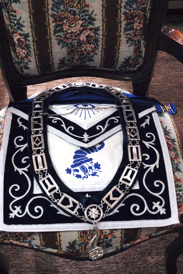 Banners and badges displaying various ranks within the society of Freemasons were on display during a one-day open house at the Fort Kent Masonic Hall. The badge of the Steward is represented by a Horn of Plenty and symbolizes the steward's duty of assuring all Masons on a worksite were fed and taken care of. In modern times the office carries similar responsibilities with the steward in charge of meeting refreshments.