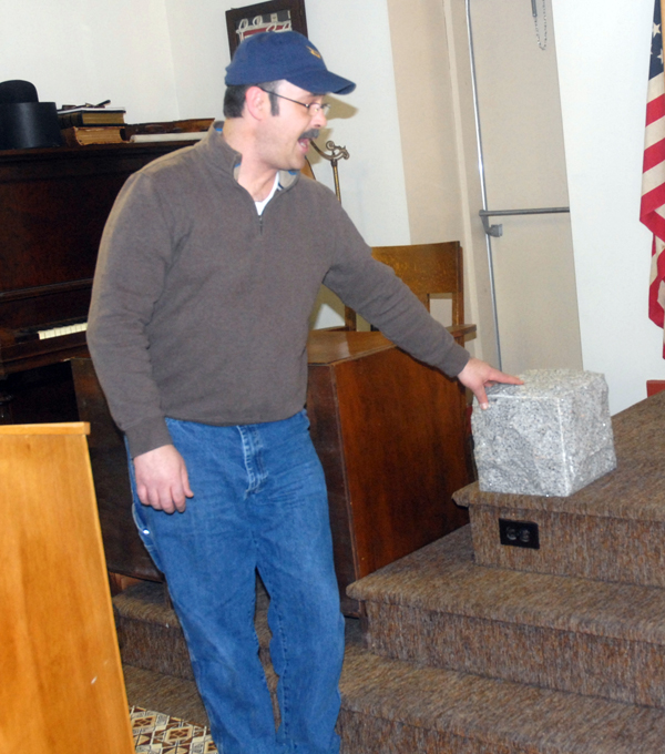 Fort Kent Freemason Brian Jandreau explains the importance of a rough cut of granite during an open house at the order's lodge Saturday. The event marked the first time the public was allowed into the meeting space in the local order's 107-year history. The Fort Kent Masonic Hall building is slated for demolition this spring to make way for a new international bridge.