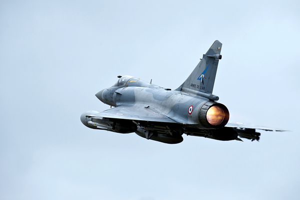 A French Mirage 2000 jet fighter takes off for Libya at the military base of Dijon, central France on Saturday.