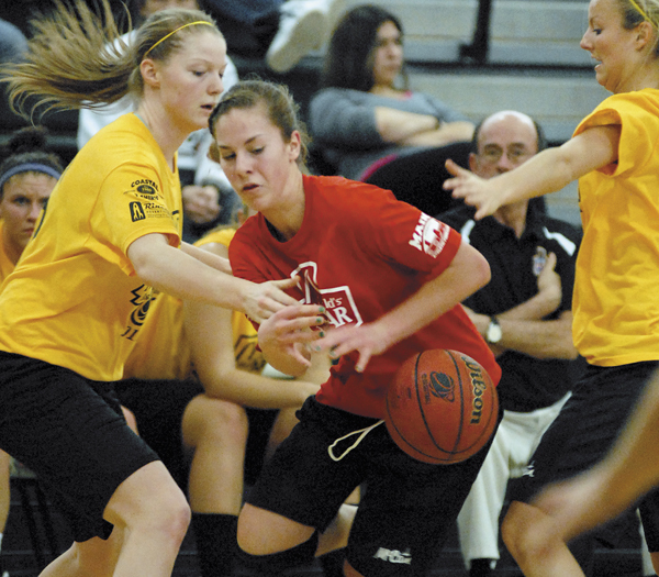A-B West's Nicole Taylor, York H.S., strips the ball from A-B East's Jenna Selander, Caribou H.S., during the 2011 Maine McDonald's High School All-Star basketball games at Husson University on Saturday.