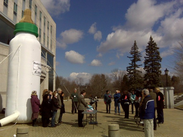 About a dozen people employed a 20-foot-tall inflatable baby bottle as a backdrop on Friday, March 25, 2011, as they held a press conference outside of the State House to urge lawmakers to ban the chemical bisphenol-A, or BPA, in reusable beverage containers. A legislative committee is holding a public hearing on the proposed ban on Friday afternoon.