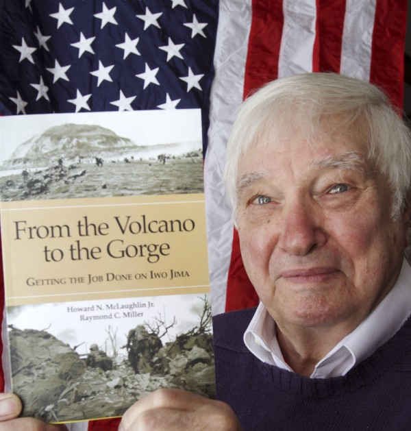Raymond Miller, 86, holds up a copy of the book that he helped write, &quotFrom the Volcano to the Gorge: Getting the Job Done on Iwo Jima.&quot