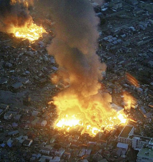 Buildings burn in Yamada town, Iwate prefecture, after Japan's biggest recorded earthquake hit Friday March 11, 2011.