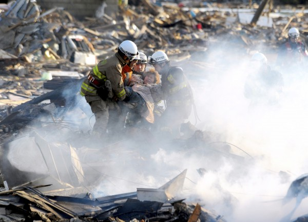 A resident is rescued from debris in Natori, Miyagi, northern Japan Saturday, after one of the country's strongest earthquakes ever recorded hit its eastern coast on Friday.