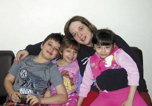 Heidi Alsaleh and her children pose for a family photo recently in Amman, Jordan. The Alsaleh family recently was released from a safe house in Jordan, where they have been for most of the past six months. The children, from left, are Ahmed, 9, Manar, 6, Sarah, 5.