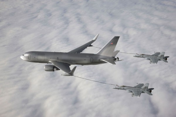 The New Generation (NewGen) Boeing KC-46A Tanker demonstrates its ability to simultaneously refuel two F/A-18 Super Hornet aircraft from the wing air refueling pods. Photo courtesy of The Boeing Company.