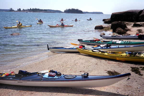 Students in the sea kayak guide class taught by Karen Francouer and Jeff Strout, land on Russ Island off Stonington.