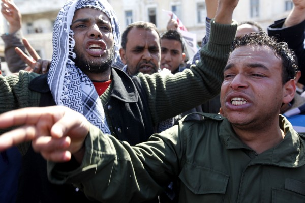 Anti-Libyan leader Moammar Gadhafi rebels mourn a colleague who was killed during fighting against pro-Gadhafi forces.