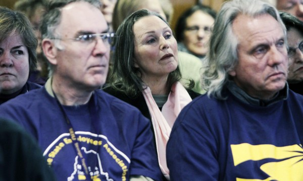 People listen to testimony before members of the Legislature's Appropriations Committee during a hearing at the State House in Augusta, Maine, on Wednesday, March 2, 2011. Union members upset with the governor's proposals to change the pension system gathered at the State House.