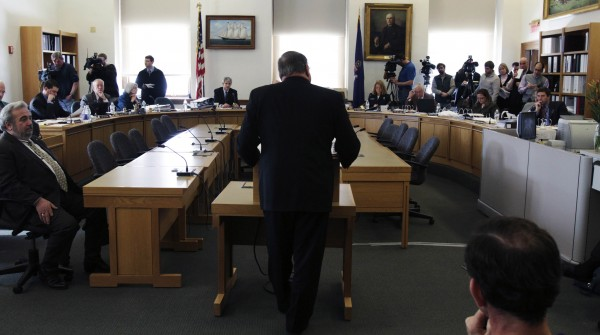Gov. Paul LePage (center, with back to camera) addresses members of the Legislature's Appropriations Committee during a hearing at the State House in Augusta, Maine, on Wednesday, March 2, 2011. Union members upset with the governor's proposals to change the pension system gathered at the State House.