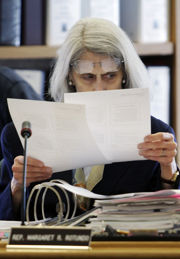 Rep. Margaret Rotundo, D-Lewiston, a member of the Legislature's Appropriations Committee, studies documents during a hearing at the State House in Augusta, Maine, on Wednesday, March 2, 2011. Union members upset with the governor's  proposals to change the pension system gathered at the State House.