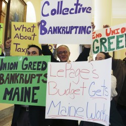 Proponents of Maine Gov. Paul LePage's proposals to change the pension system gathered in the Hall of Flags at the State House in Augusta, Maine, on Wednesday, March 2, 2011.