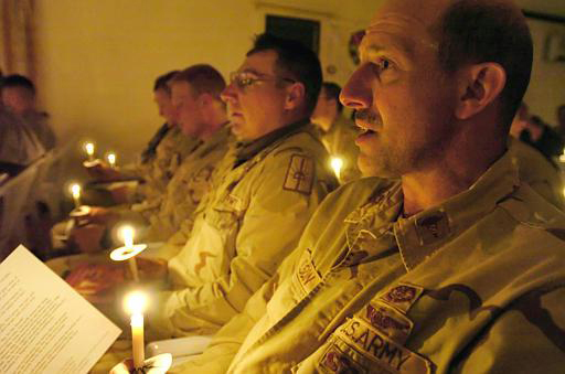U.S. Army retired Major John Nelson (right) seen here participating in a religious service in Mosul, Iraq, will receive the military's Legion of Merit and Maine Silver Star awards during ceremonies in Lincoln on Thursday in recognition of his development and implementation of a mass casualties plan in Mosul that saved dozens of lives from a suicide bomber attack in 2004. PHOTO COURTESY OF JOHN NELSON.
