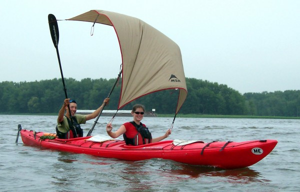 "Darian Higgins (above, left), 22, of Ed-dington and Rachel Knobloch, 23, of Ed-dington improvise a sail on their tandem kayak while cruising down the Mississippi River in August 2006. The ""sail"" is the fly from their tent. Students in the sea kayak."