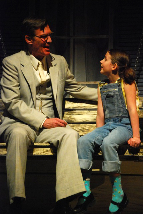 Atticus played by Matthew Conlon (left) and Scout played by Brooke Jones. Penobscot Theatre Company presents Harper Lee's To Kill A Mockingbird, March 30-April 17 at the Bangor Opera House.
