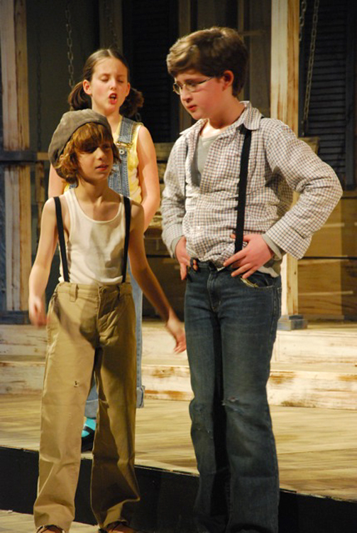 Dill (Noam Webster, from left), Scout (Brooke Jones) and Jem (Nick Danby)  Penobscot Theatre Company presents Harper Lee's To Kill A Mockingbird, March 30-April 17 at the Bangor Opera House.
