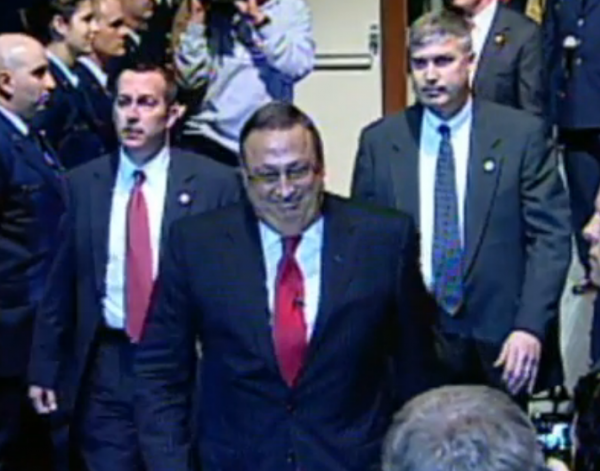 Paul LePage, seen in this January photo, is flanked by two plainclothes policemen at all times. The governor's office added extra security by posting a uniformed officer outside LePage's door in the State House.