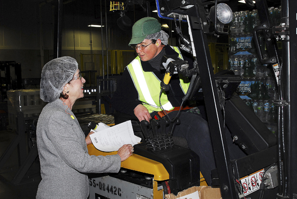 Sen. Susan Collins chats with Jean Parron of Skowhegan, who's operating a forklift at the Poland Spring Kingfield plant on Wednesday.