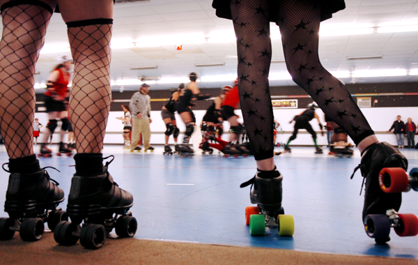Maine Roller Derby's Vacationland Vixens, Lauren Lavigne (left), of Minot and Carolyn Turner, 30, of Portland support their teammates during a public scrimmage against Pioneer Valley Ropller Derby of Northhampton, Mass., at Roller World in Topsham in 2007.